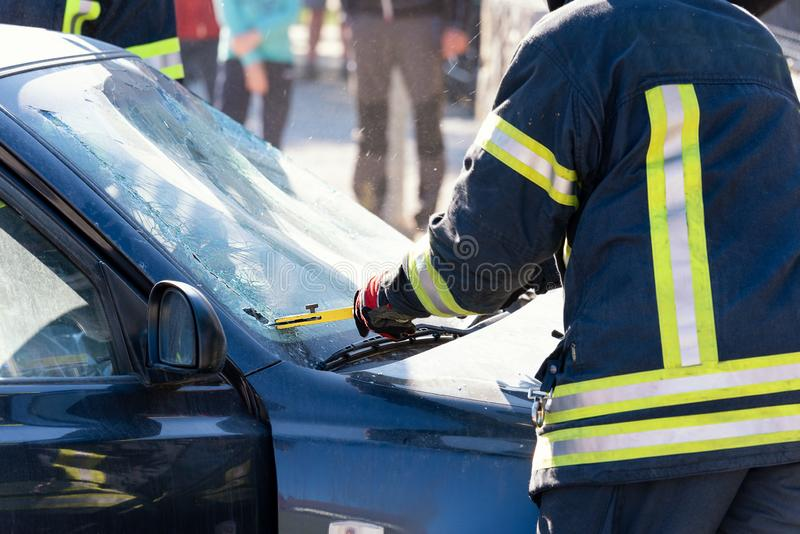 Firefighters, fire man cut a car glass in car accident royalty free stock photography