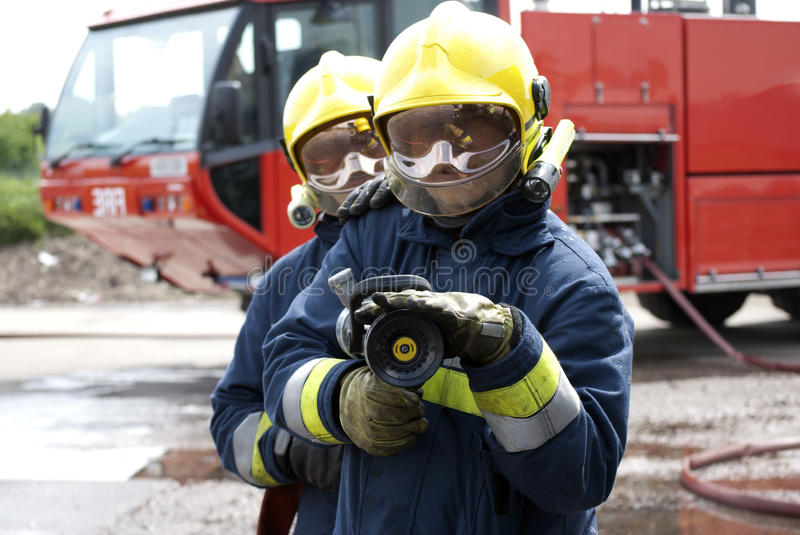 Firefighters hose stock images