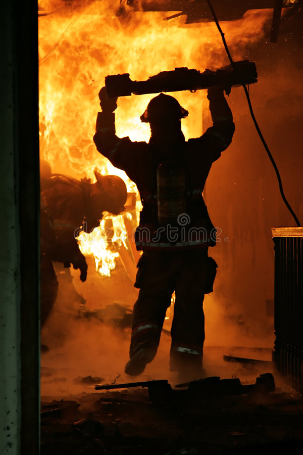 Firefighters Inside House royalty free stock image