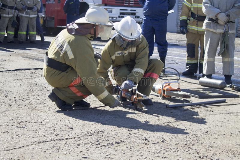 Firefighters at work. stock images