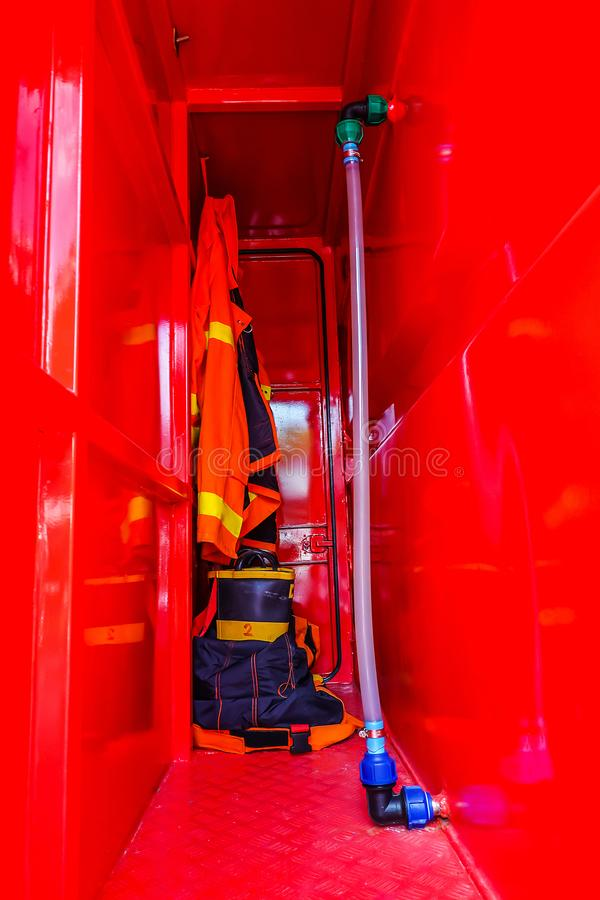 Firefighters in red fire-proof uniform royalty free stock images