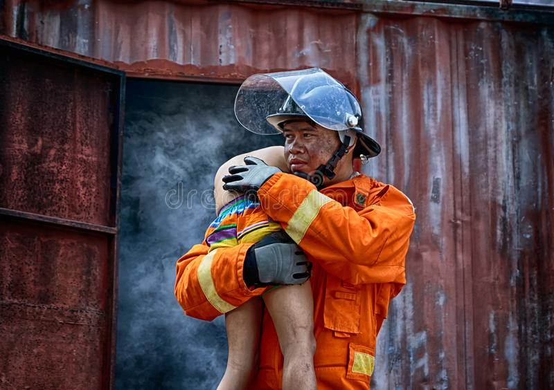 Firefighters save the boy from burnt place royalty free stock photos