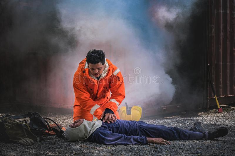 Firefighters save lives from fire making CPR royalty free stock photo