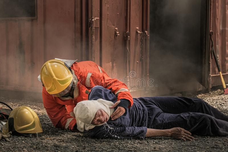 Firefighters save lives from fire making CPR royalty free stock photos