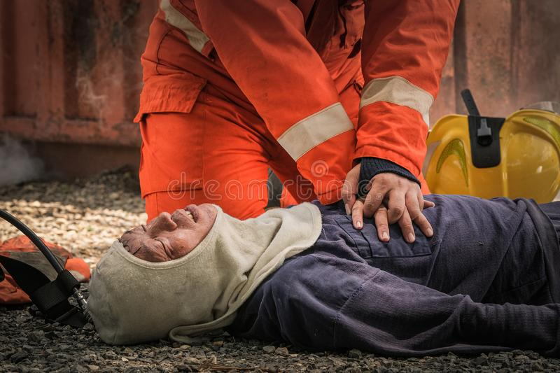Firefighters save lives from fire making CPR royalty free stock images