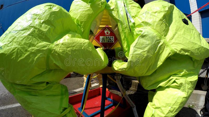 Firefighters seal leak of hazardous corrosive toxic materials. MIGDAL HAEMEK, ISRAEL - MARCH 23, 2015: Firefighters seal leak of hazardous corrosive toxic royalty free stock image