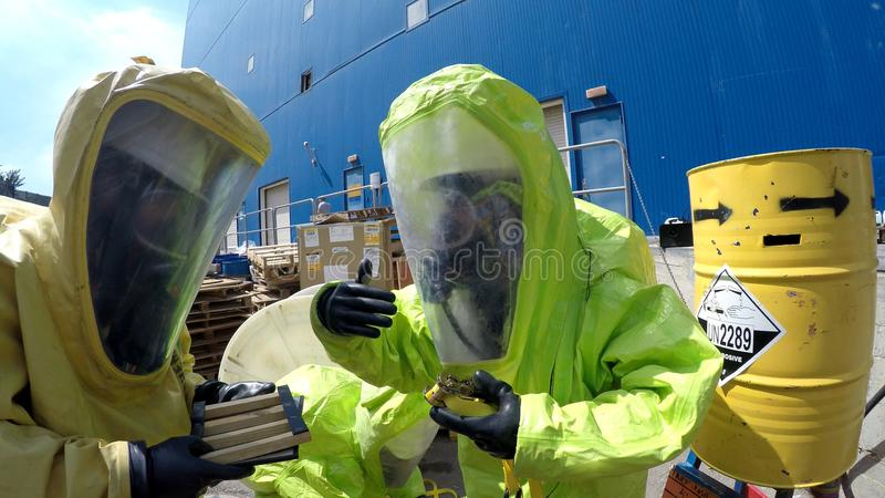 Firefighters seal leak of hazardous corrosive toxic materials. MIGDAL HAEMEK, ISRAEL - MARCH 23, 2015: Firefighters seal leak of hazardous corrosive toxic royalty free stock images