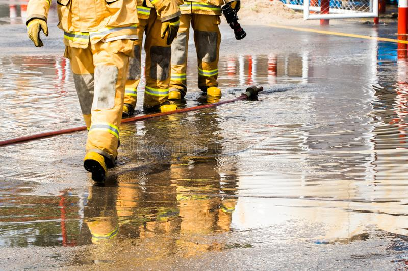 Firefighters spray water to wildfire royalty free stock image