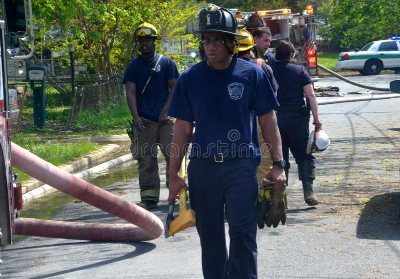 Firefighters prepare to clean up after putting a fire out  in Hyattsville, Maryland stock images