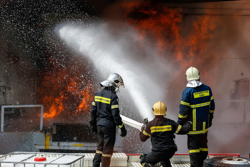 Firefighters struggle to extinguish the fire that broke out at a royalty free stock image