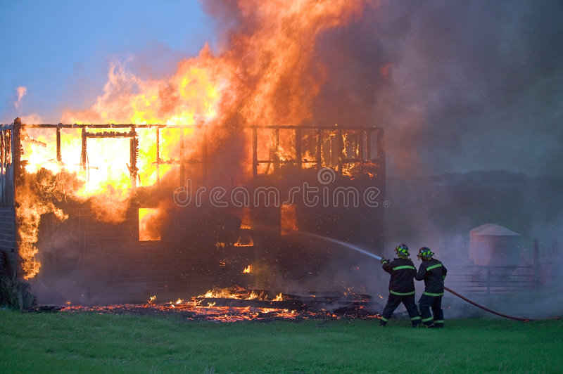 Firefighters Taking Control Royalty Free Stock Photos