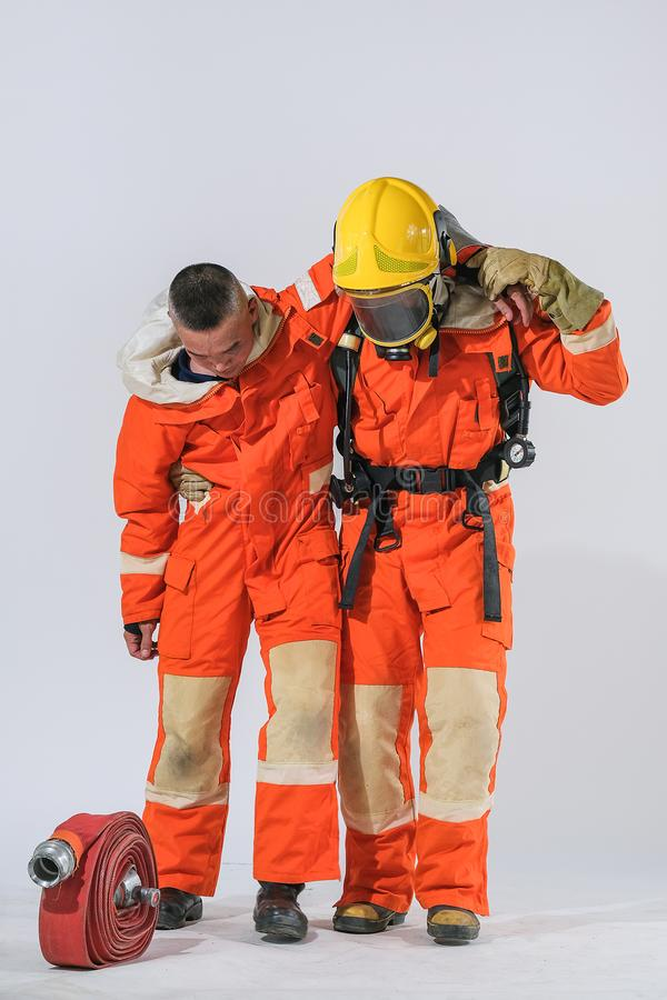 Firefighters teach how to help those who are burned stock images