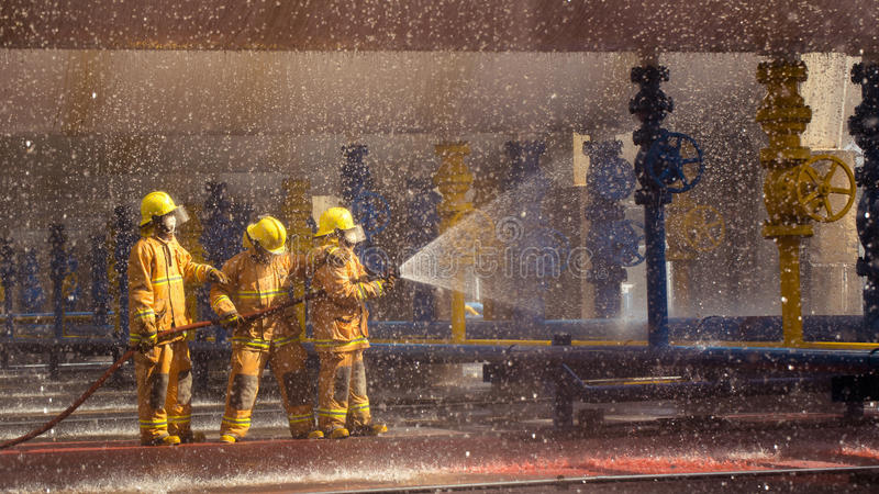 Firefighters training, foreground is drop of water springer royalty free stock photo