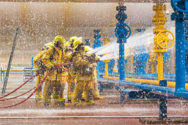 Firefighters training, foreground is drop of water springer stock image