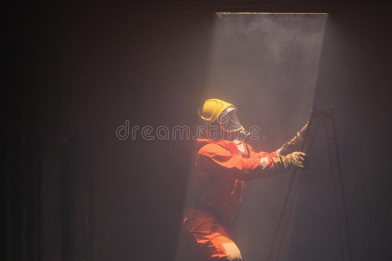 Firefighters went to rescue the fire from  chimney above. Firefighters went to rescue the fire from the chimney above royalty free stock photos