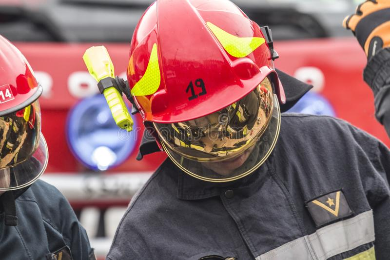 Firefighters working on an auto vehicle extrication royalty free stock image