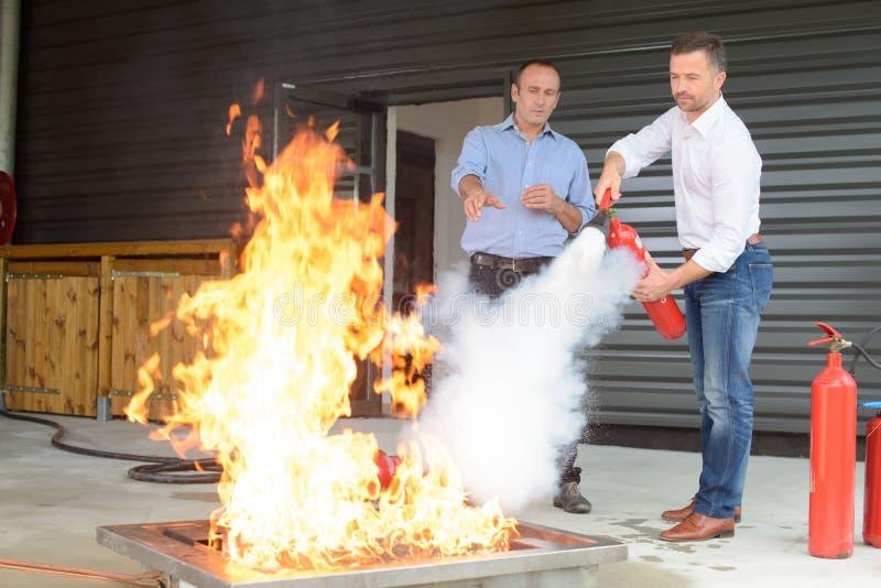 Firefighting сверлит внутри строить стоковое фото rf