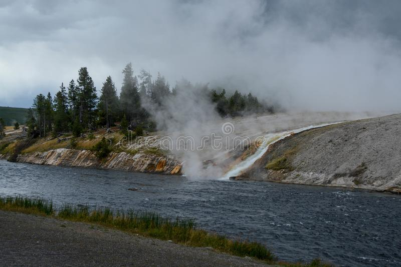 The Firehole River at the Midway Geyser Basin. A view of the Firehole River where hot water from the hot springs pools flow into the river in Yellowstone royalty free stock photo