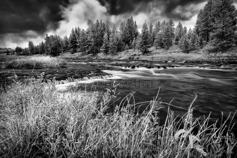 Firehole River, Yellowstone National Park. Firehole River in Yellowstone National Park under ominous fall skies royalty free stock photography
