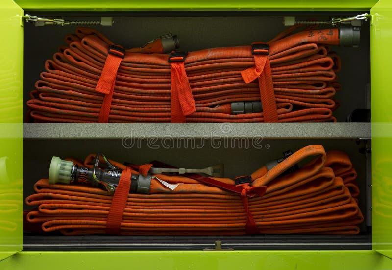Firehose in un firetruck immagine stock libera da diritti