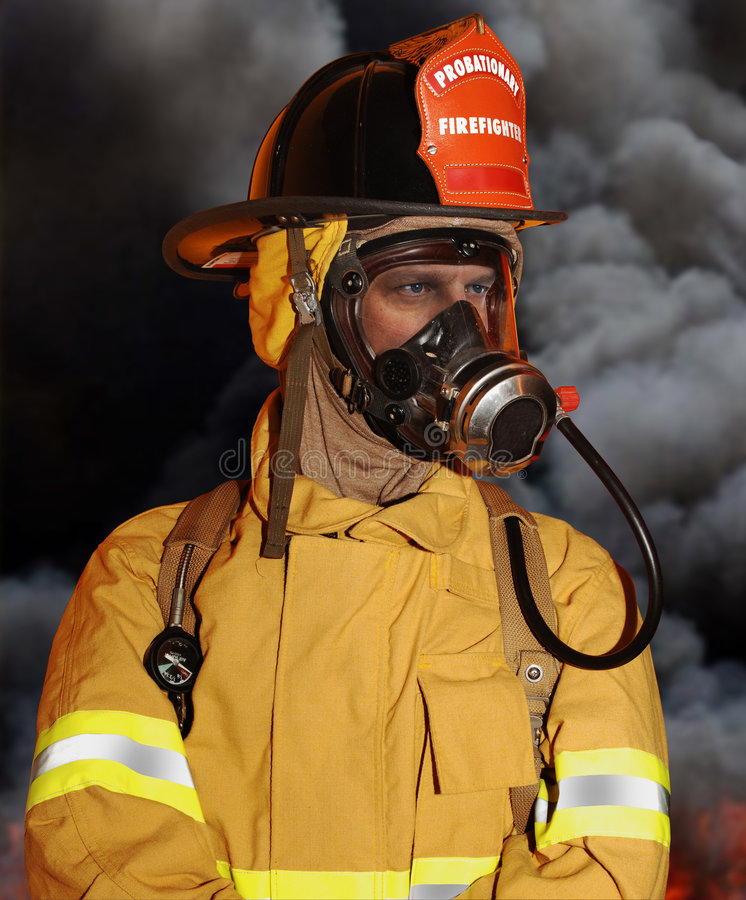 Fireman. On location with smoke in background royalty free stock images