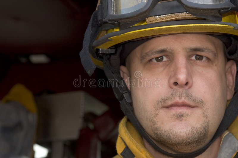 Fireman. Picture of a fireman with clothing and hat stock photo