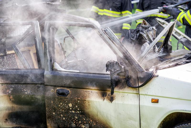 Burning car after accident royalty free stock image