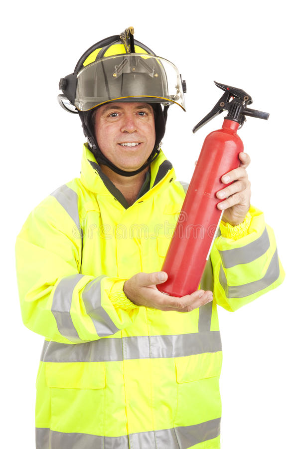 Fireman Demonstrates Fire Extinguisher stock photo