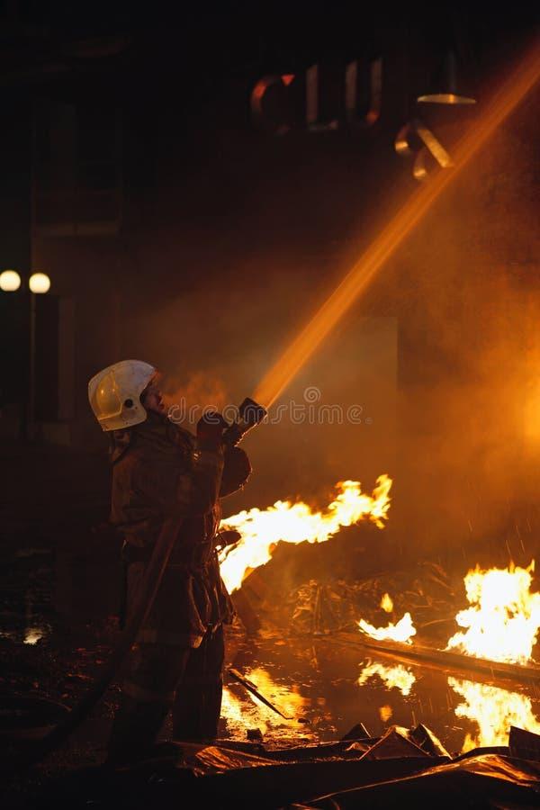 Fireman fighting a fire stock photos