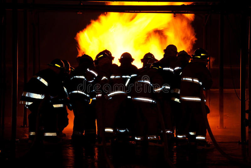 Download Fireman fighting fire stock photo. Image of flames, protection - 15416138