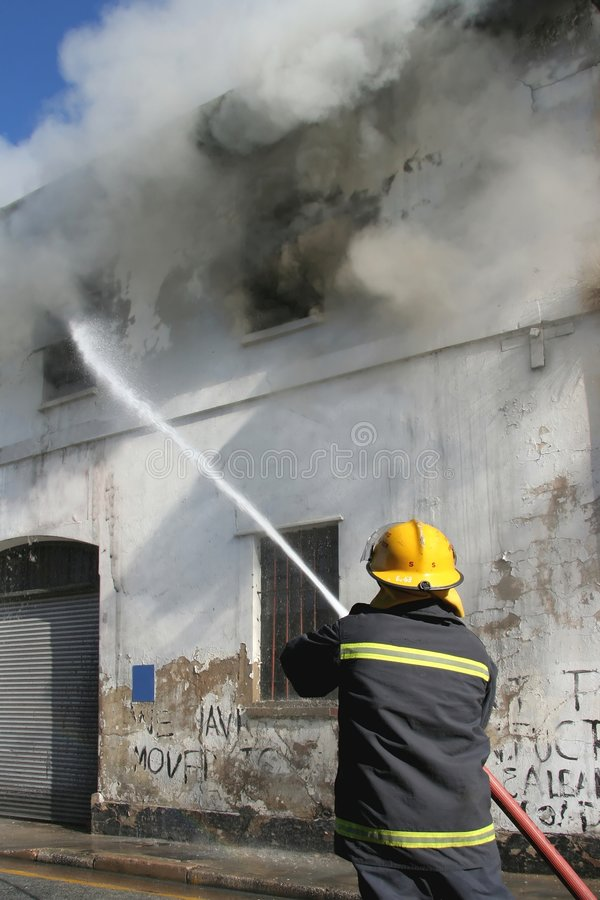 Fireman Fighting Fire stock images