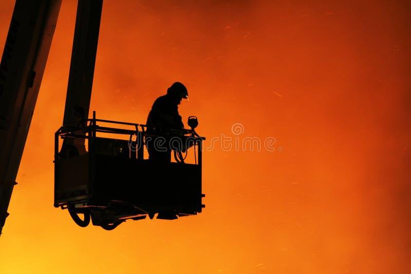 Fireman and fire stock image