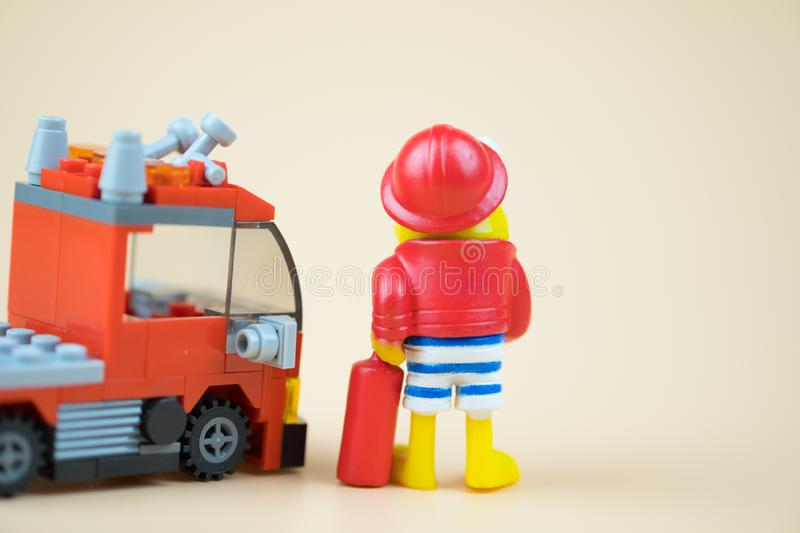 Fireman and fire truck plastic toy royalty free stock photo