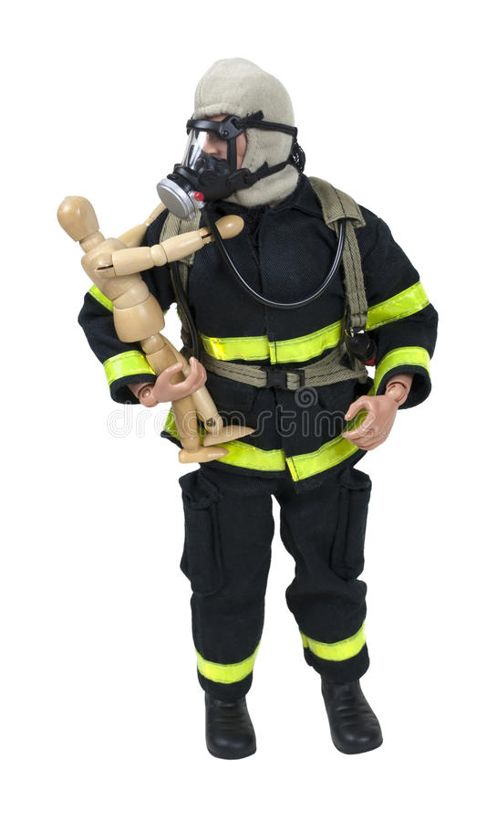 Fireman Model Holding a Wooden Child stock images