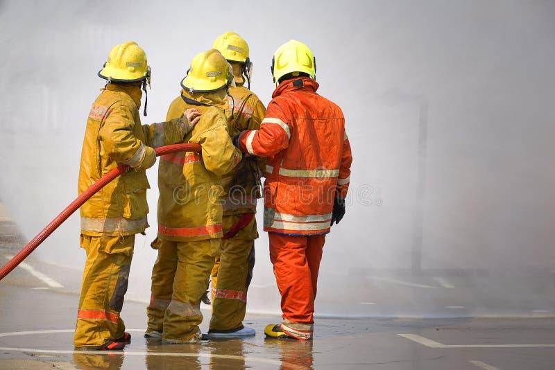 fireman O treinamento do sapador-bombeiro imagens de stock royalty free