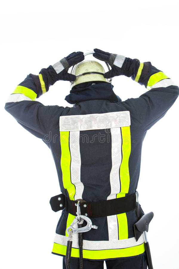 Fireman putting on his helmet royalty free stock photo