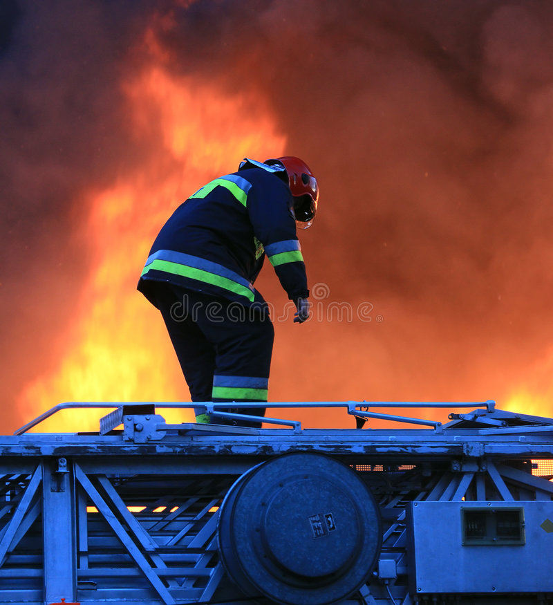 Download Fireman in risky action stock photo. Image of elements - 6211106