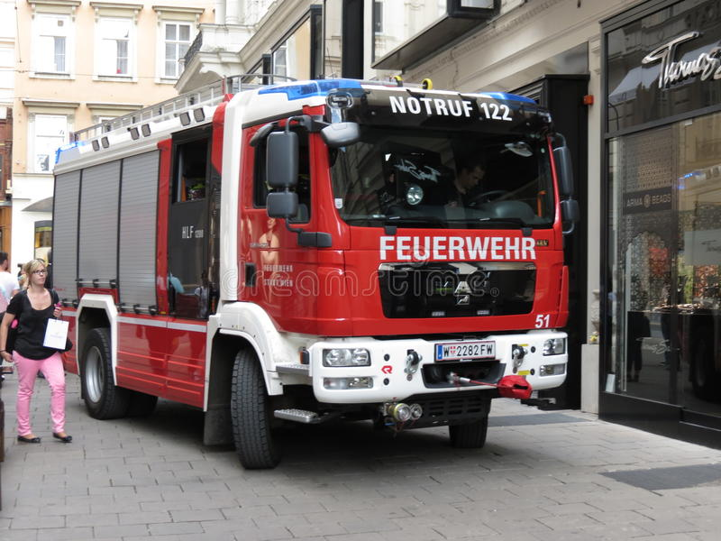 Fire brigadetruck in Vienna. VIENNA, AUSTRIA - CIRCA JUNE 2014: Feuerwehr (meaning Fire brigade) truck stock photography