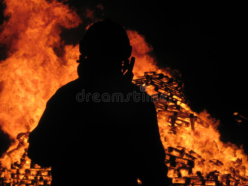 Fireman watches over inferno royalty free stock photography