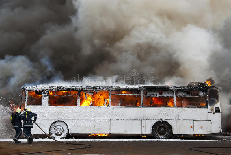 Firemen. Fighting a bus fire