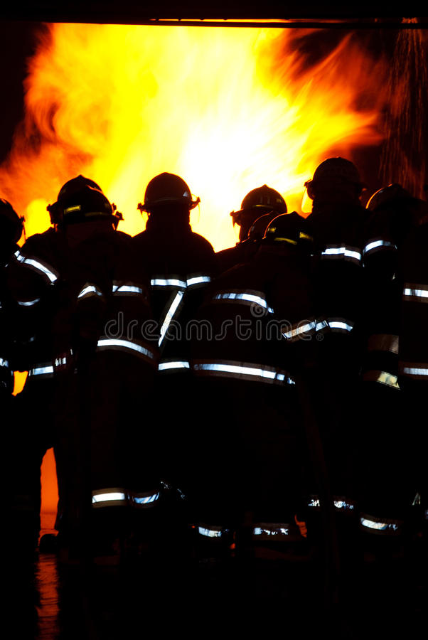 Download Firemen attacking a fire stock image. Image of protective - 15416129