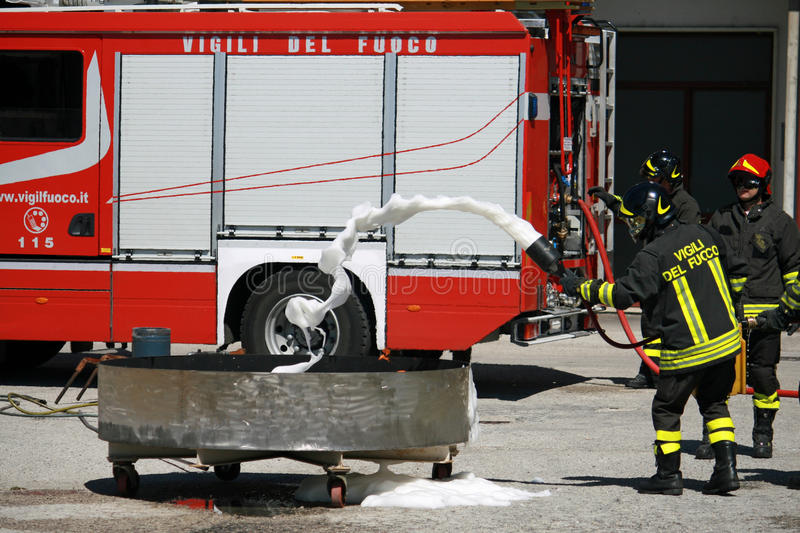 Firemen extinguish a simulated fire. Italian Firemen extinguish a simulated fire during an exercise in their Firehouse royalty free stock photo