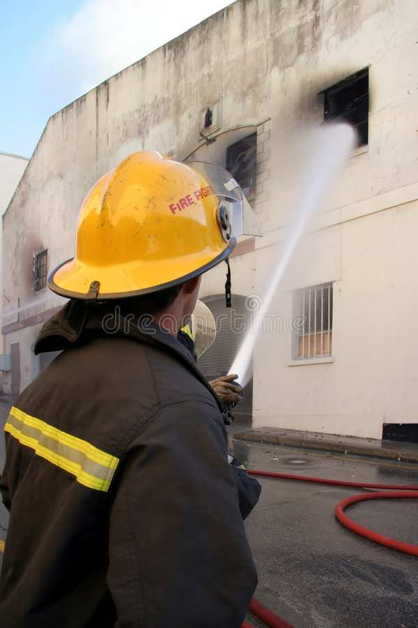 Free Firemen Fighting Fire Stock Photos - 5997443