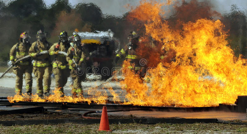 Firemen putting out fire stock photography