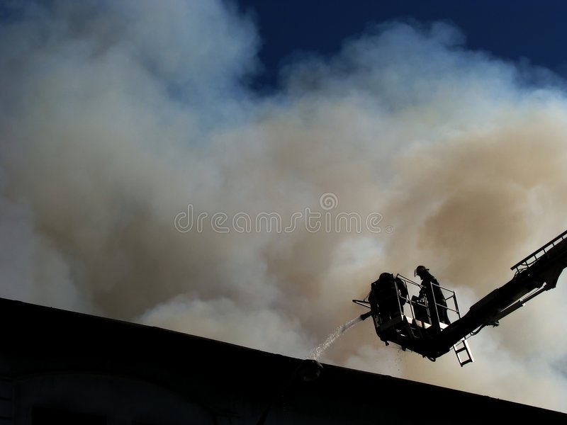 Firemen on snorkel stock images