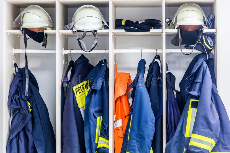 Firemen suits and helmets royalty free stock images