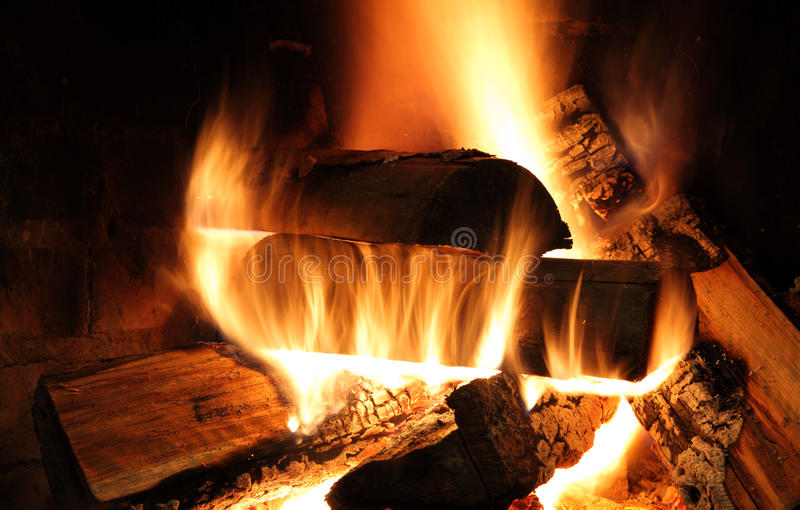 In the fireplace. Wood burning in the fireplace, photographed at long exposure stock photos