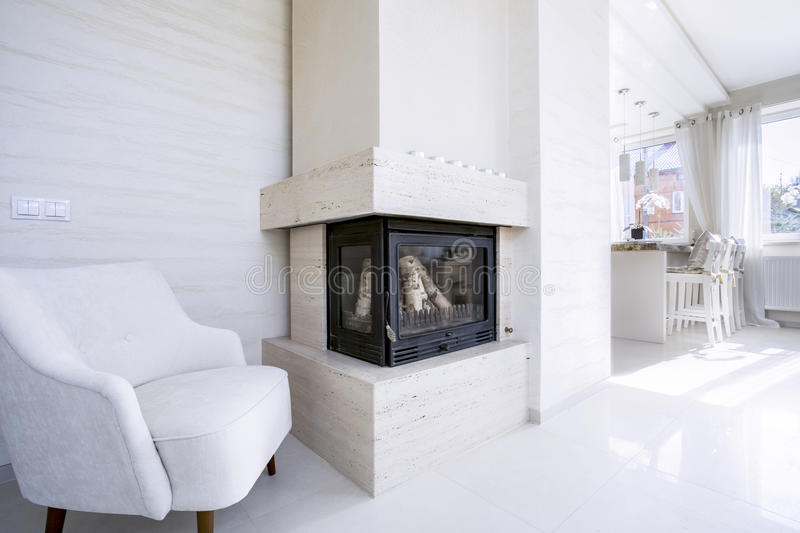 Fireplace in bright house stock images