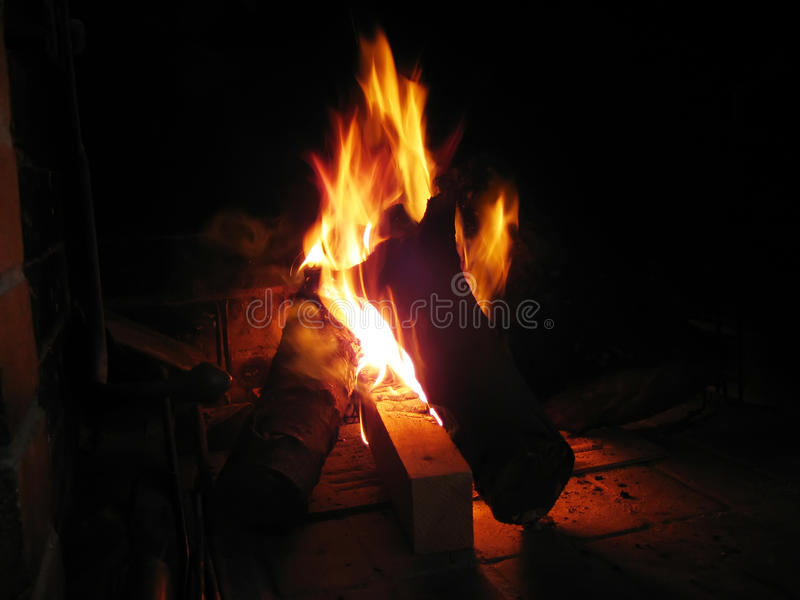 Fireplace and burning flames stock image