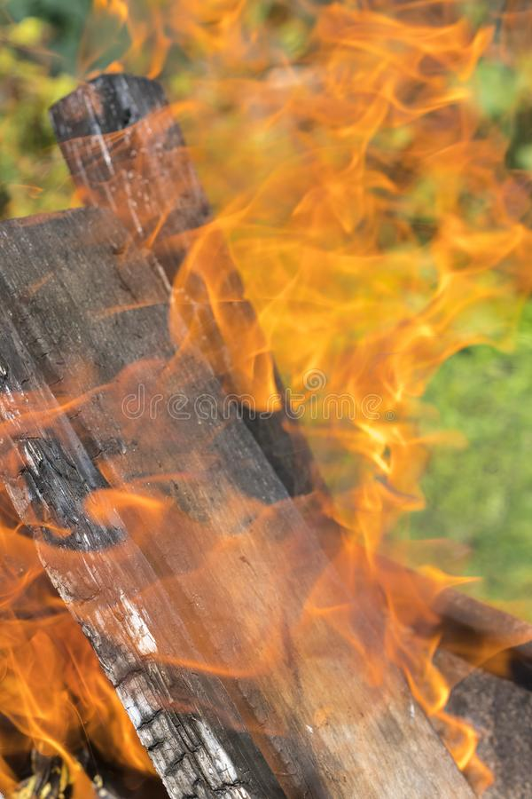 Fireplace burning. Warm cozy burning fire in a brick fireplace close up. Cozy background. Bonfire in nature. Fire royalty free stock photos